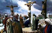 Jesus on his  cross between two others in the midst of a crowd of onlookers